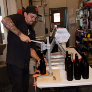 triple-voodoo-hand-bottling